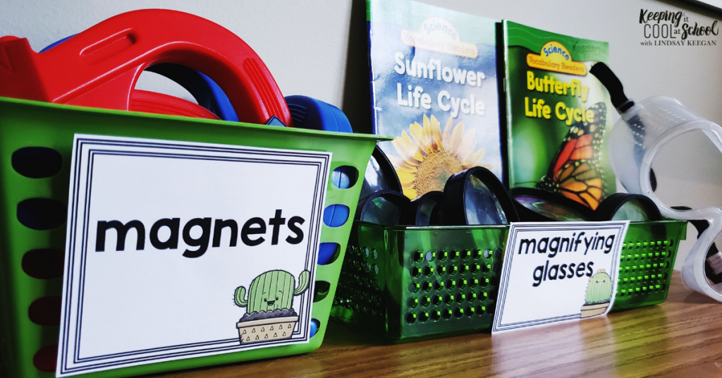 Labeled bins for magnets and magnifying glasses in a science corner.